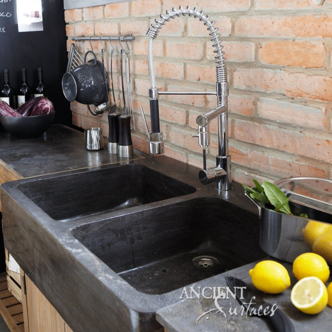 Hand Carved Double Basalt Sink with Reclaimed Bricks Back Splash.