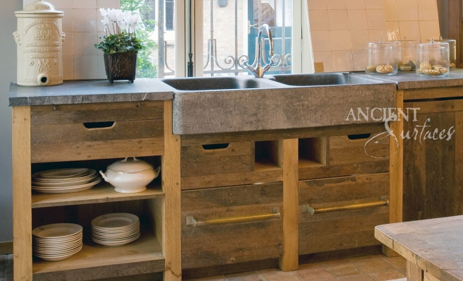 Hand Carved Double Basalt Sink with Reclaimed Wood Cabinets and Antique Stone Floors.