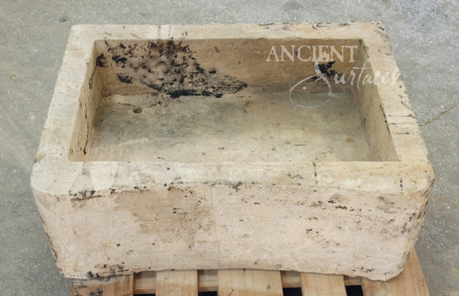 A perfect ergonometrically carved limestone sink reclaimed from a French farmhouse.