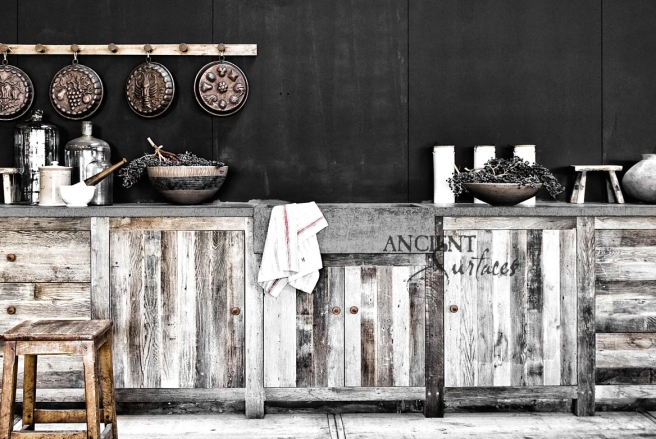 Hand Carved Basalt Sink Installed with Reclaimed Wood Cabinets and Antique Stone Floors.