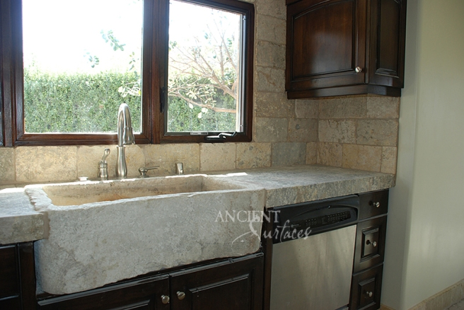Antique Biblical Stone on the backsplash, antique foundation Slabs on the counter tops and a reclaimed 400 years old Italian Farmhouse sink.