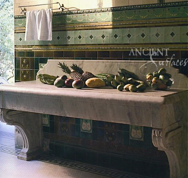 Custom carved Marble preparation table with corbeled legs by Ancient Surfaces.